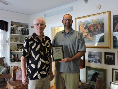 Anthony presents the 2015 ChelEd Award to Dr. Peter Pritchard